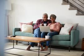 couple_couch_computer_shutterstock_1125902945.jpg
